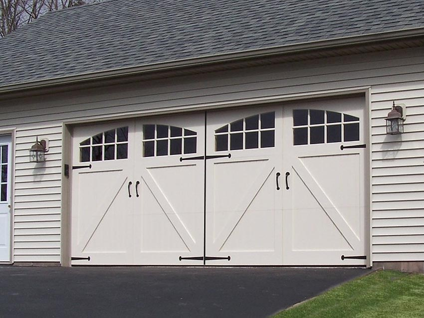 It looks like wood, but it's low-maintenance steel. The historical roots of swing-out, hand-opened carriage house garage doors translates to current day electronic functionality and curb-appeal style to enhance your home.