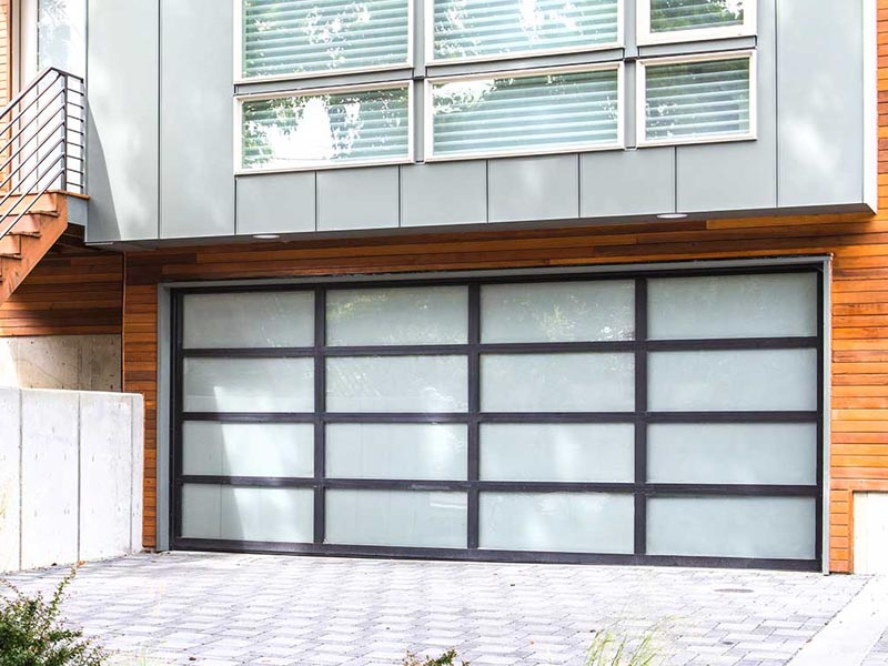 With the beauty of aluminum integrated with steel and high density polystyrene for strength, contemporaty garage doors not only are energy efficient, but make a definite design statement with your home's architecture.