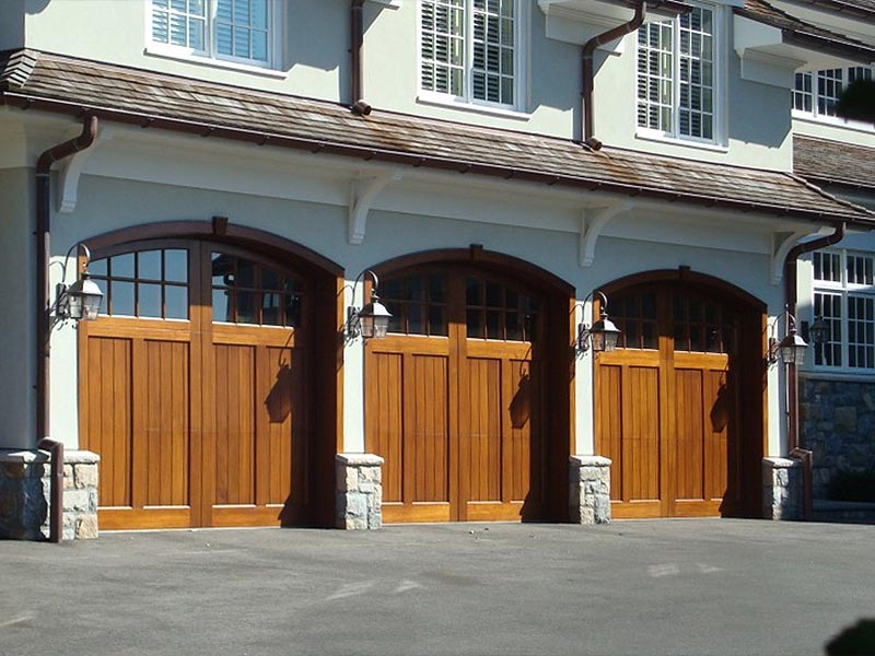 Combining beauty and strength, there's no alternate to distinctive, warm, wood-grain doors. From factory selections to custom one-of-a-kind designs, real wood garage doors dramatically increase your home's curb appeal.