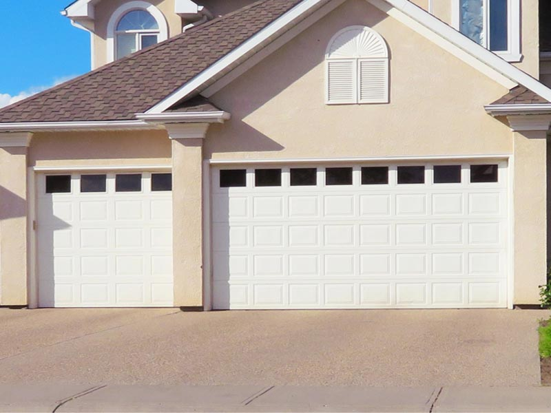 Raised panel durable steel materials with color options available, superior insulation R-value and low maintenance — with or without windows, these doors will continuing to perform at high levels for years.